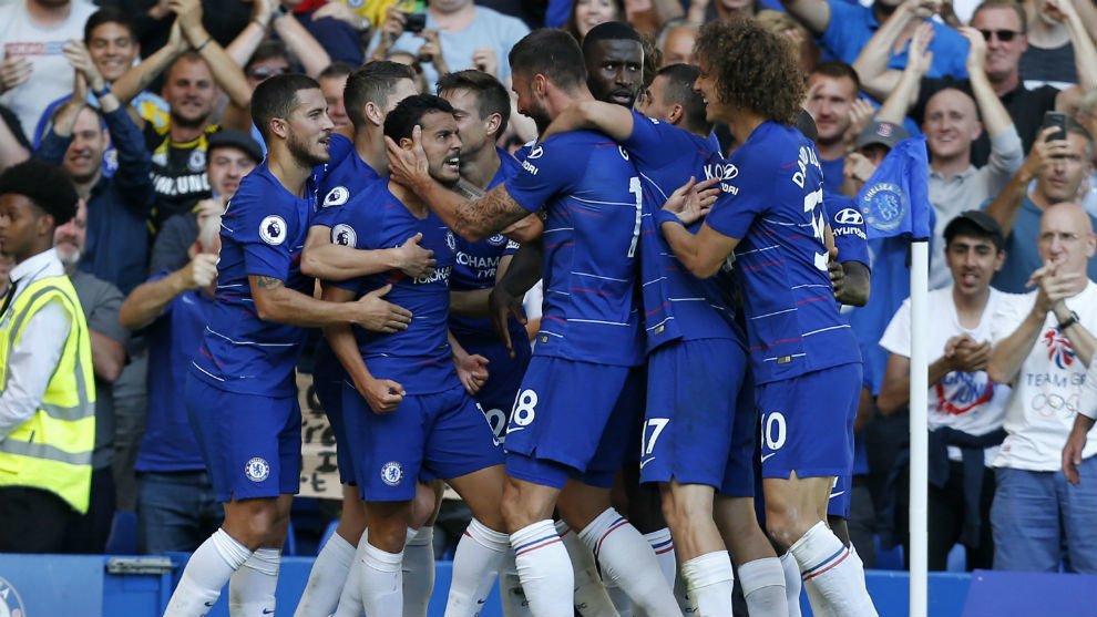 Chelsea's Spanish midfielder Pedro celebrates with teammates after...