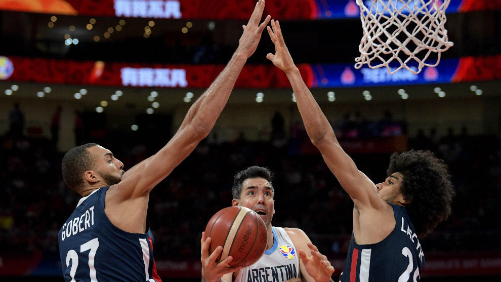 Luis Scola trying to score with Rudy Gobert and Louis Labeyrie looking...