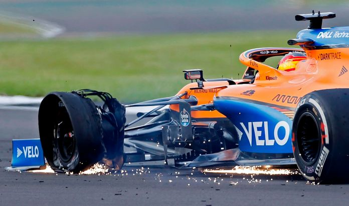 The punctured tyre of McLarens Spanish driver lt;HIT gt;Carlos lt;/HIT gt; lt;HIT gt;Sainz lt;/HIT gt; Jr is picture as he nears the finish of the Formula One British Grand Prix at the Silverstone motor racing circuit in Silverstone, central England on August 2, 2020. - Lewis Hamilton survived a dramatic finale to win the British Grand Prix on Sunday, just making it across the line on three tyres to beat a fast closing Max Verstappen on Red Bull. The defending world champion claimed his seventh British Grand Prix win as Ferarris Charles Leclerc came third and Daniel Ricciardo of Renault fourth. (Photo by ANDREW BOYERS / POOL / AFP)