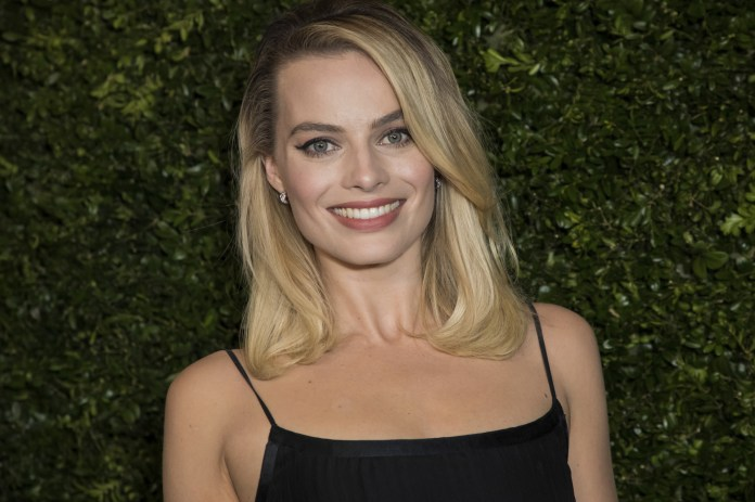 Margot Robbie with long hair blonde and long fringe to one side