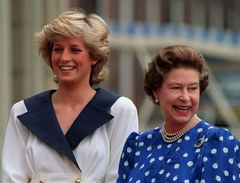 Diana of Wales with her long bob hair grown next to Elizabeth II.