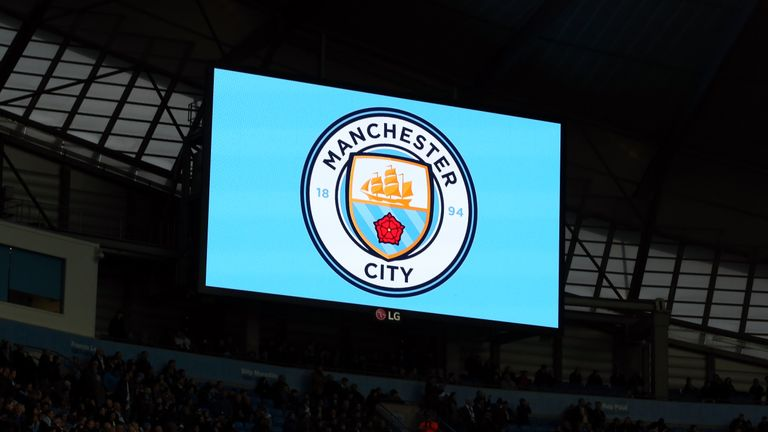 The new Manchester City club crest is displayed on the big screen before the Premier League match against Sunderland at the Etihad Stadium
