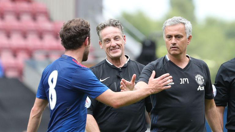Jose Mourinho congratulates Juan Mata (left) after Man Utd's victory