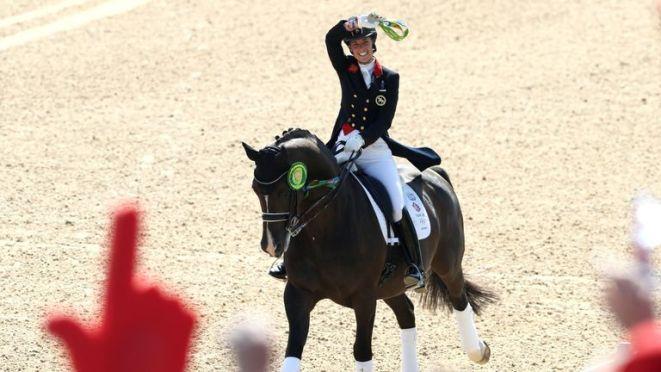 Charlotte Dujardin of Great Britain riding Valegro celebrates her gold medal