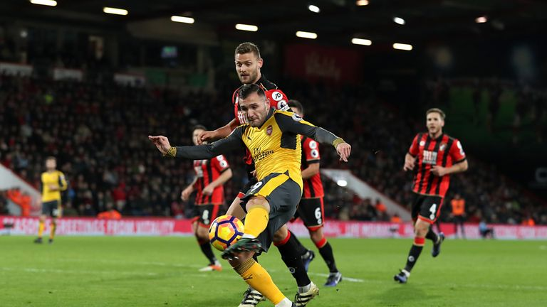Arsenal's Lucas Perez scores his side's second goal of the game