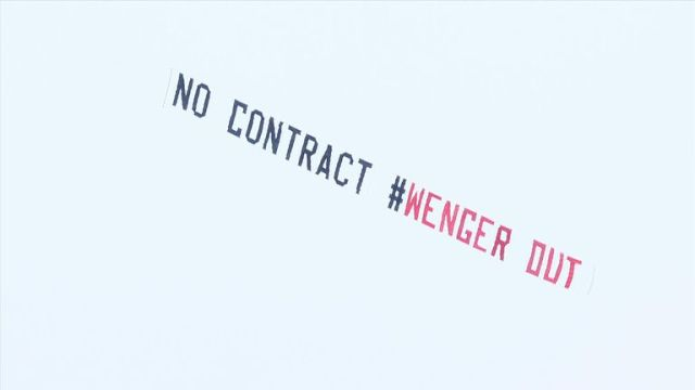 Banners have been flown over stadiums this season asking for Wenger to leave