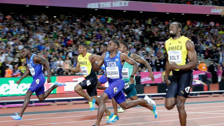 Gatlin (L) came with a strong late burst to claim his second world 100m title, 12 years after his win in Helsinki