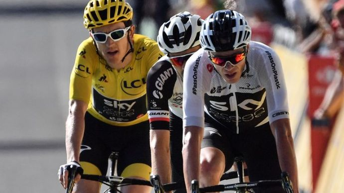 (From R) Christopher Froome, Tom Dumoulin and Geraint Thomas, who run the wearing yellow jersey of the overall leader, crossing the finish line of stage 14