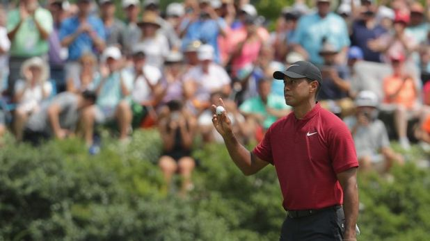 Woods carded eight birdies in a 64 but finished two behind Brooks Koepka