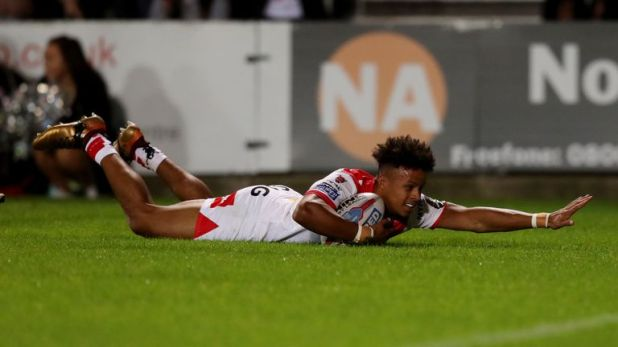 Regan Grace scoring one of his two tries against Hull FC