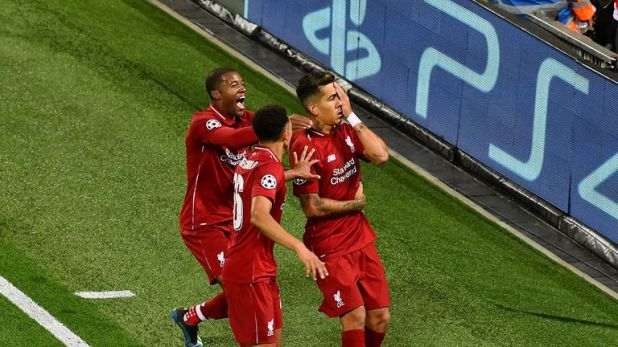 Roberto Firmino celebrates by covering one eye after scoring Liverpool's winner
