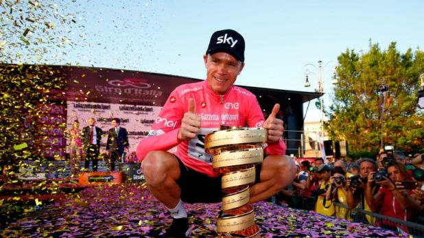 Chris Froome poses with the Giro d'Italia trophy
