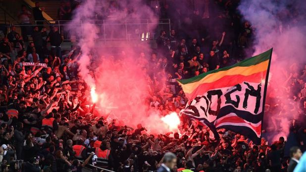 Fans lit fireworks inside the stadium and clashed outside