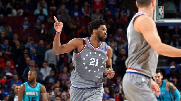 Joel Embiid celebrates during Philadelphia's overtime win over Charlotte
