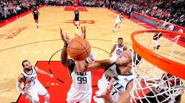 Rim protector Rudy Gobert corrals a rebound for the Utah Jazz