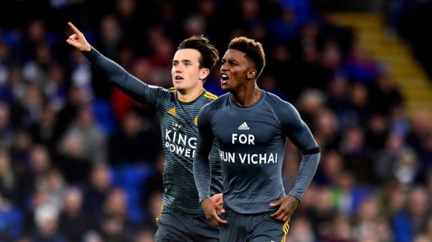 Demarai Gray (right) was booked for taking his shirt off after celebrating his goal against Cardiff
