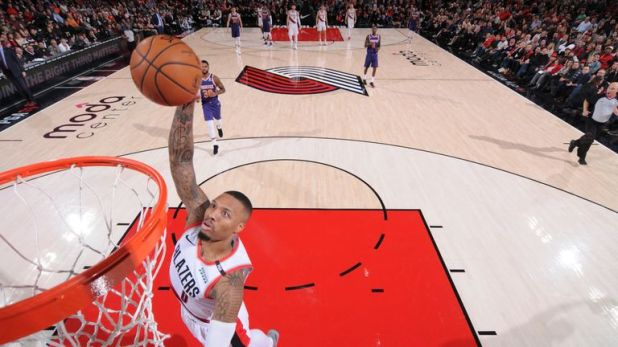 Damian Lillard scores with a breakaway dunk