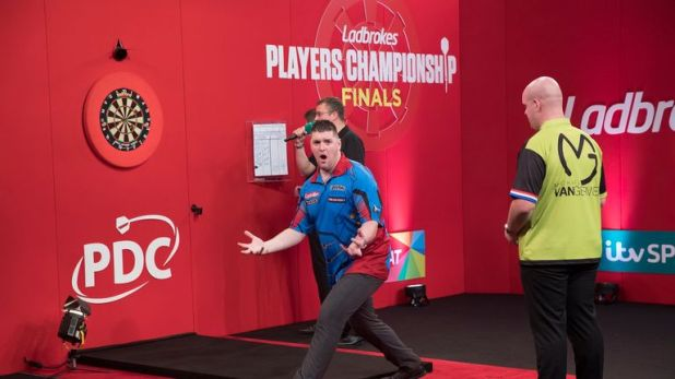 Gurney reacts after hitting the bullseye to beat MvG in the Players Championship Finals. Via Lawrence Lustig/PDC