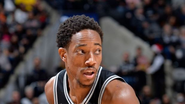 DeMar DeRozan #10 of the San Antonio Spurs handles the ball against the Utah Jazz on December 9, 2018 at the AT&T Center in San Antonio, Texas.