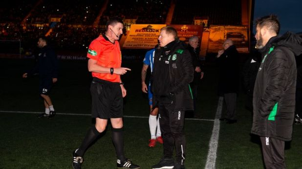 Hibs manager Neil Lennon chats with referee Craig Thomson following a floodlight failure at Kilmarnock