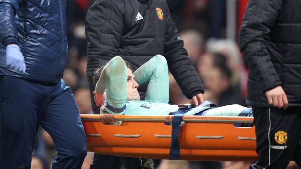 Rob Holding was stretchered off at Old Trafford