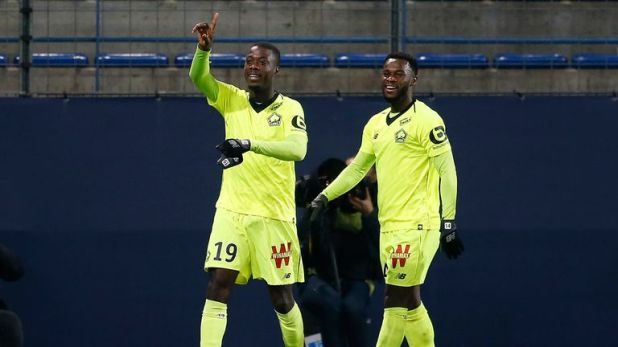 Nicolas Pepe (L) celebrates after scoring during Lille's 3-1 win at Caen