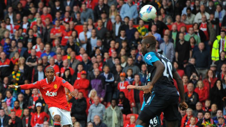 Ashley Young curls in Manchester United's eighth goal in their 8-2 thrashing of Arsenal