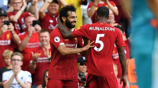 Mohamed Salah celebrates with Gini Wijnaldum after scoring for Liverpool against Arsenal