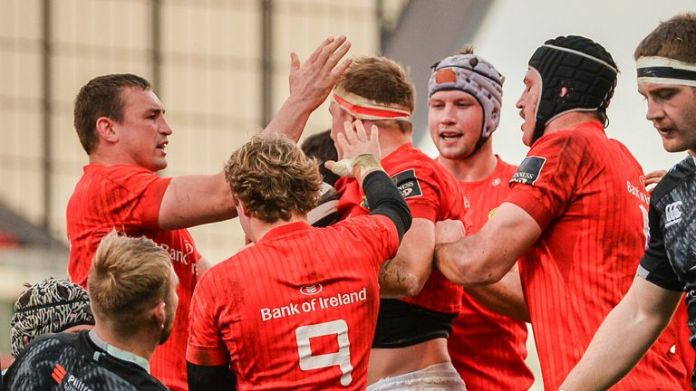 Munster celebrate one of Gavin Coombes' tries in their win over Ospreys