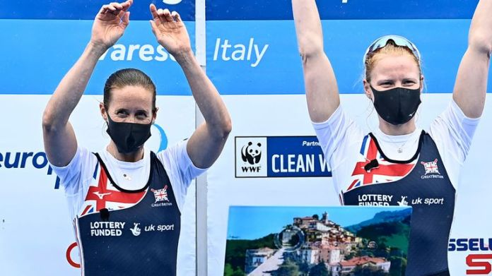 Helen Glover and Polly Swann of Great Britain celebrate on the podium after winning gold in the European Rowing Championships