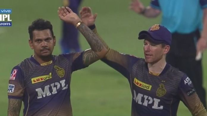 Sunil Narine (L) celebrates a wicket with Kolkata Knight Riders captain Eoin Morgan