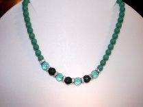 A oresent for a friend. She chose the small green beads and I worked around them. I do like the result.