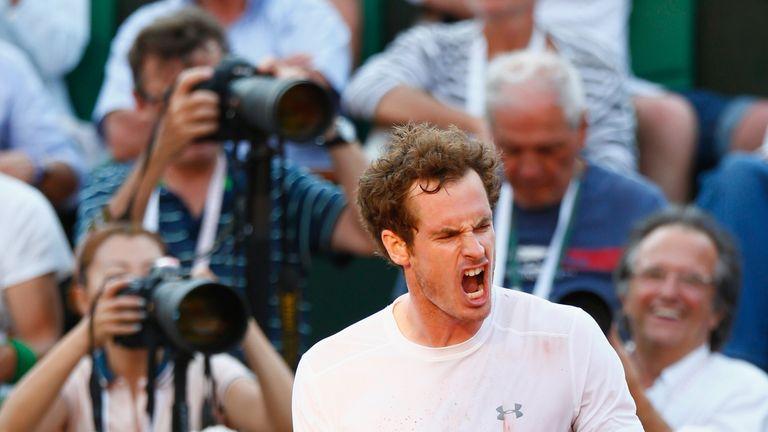 Andy Murray celebrates winning the third set