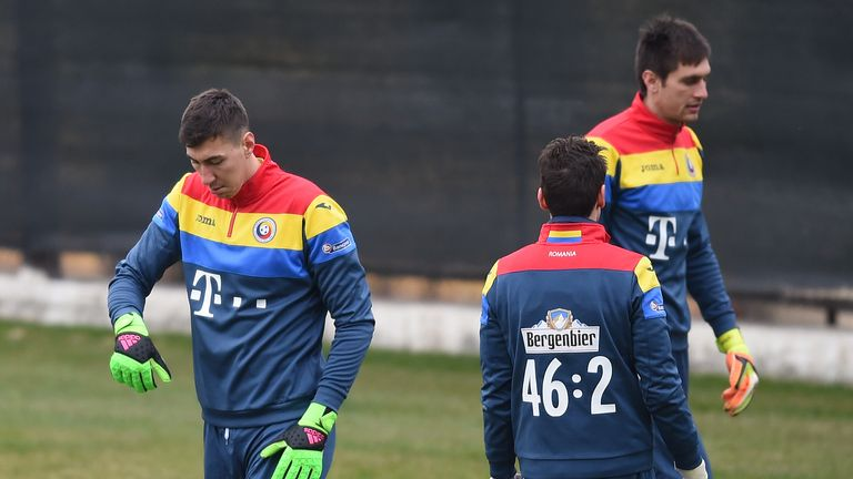 Romania have picked Sunderland goalkeeper Costel Pantilimon (l) in their squad