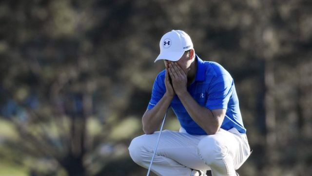 Reality dawns for Spieth on the 18th green at Augusta