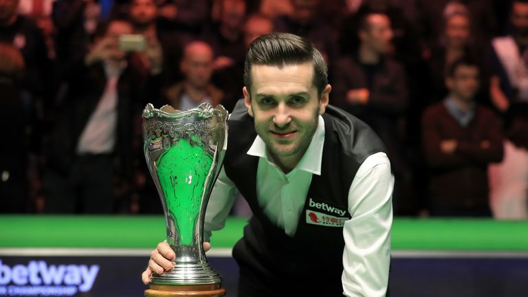 Mark Selby celebrates with the Betway UK Championship trophy