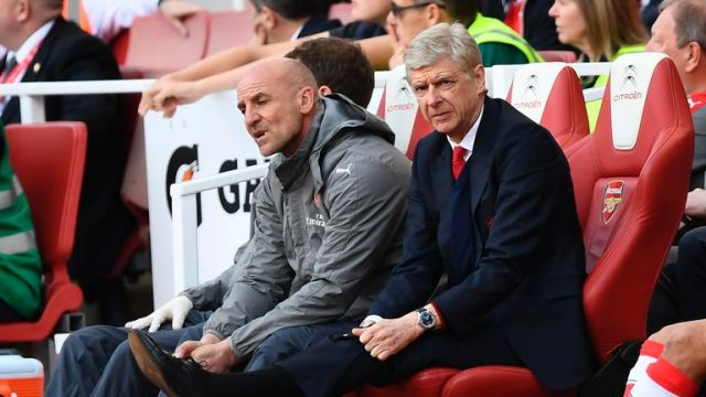 Arsene Wenger cuts a dejected figure in the dugout at the Emirates Stadium