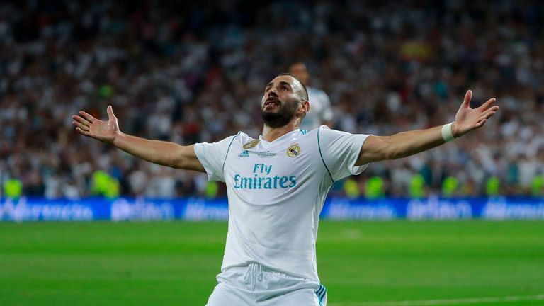 Karim Benzema celebrates after scoring the second goal of the evening