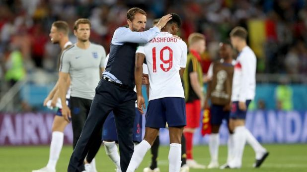 Southgate consoles Marcus Rashford after the 1-0 loss to Belgium