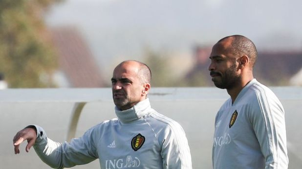Martinez brought in Thierry Henry (right) as his Belgium assistant