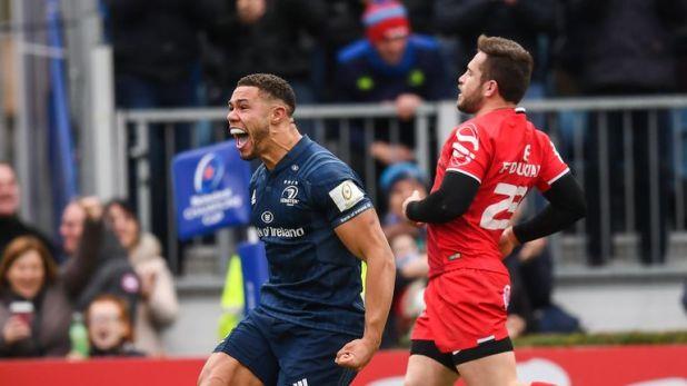 Adam Byrne celebrates after scoring Leinster's bonus-point try