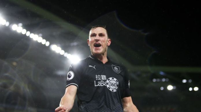 Chris Wood celebrates his second goal for Burnley