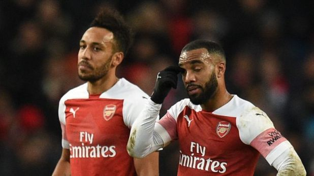 Pierre-Emerick Aubameyang and Alexandre Lacazette react to a Man City goal