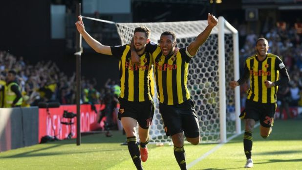 Deeney and Craig Cathcart celebrate Watford's win against Tottenham at Vicarage Road in September