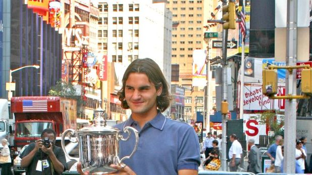 Federer celebrates the second of his five successive US Open titles in 2004