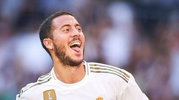 Eden Hazard celebrates after scoring for Real Madrid against Granada