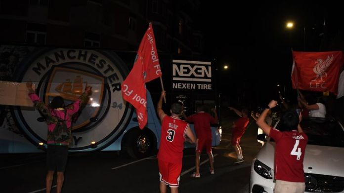 Some Liverpool supporters celebrated outside Stamford Bridge as the Manchester City team bus departed