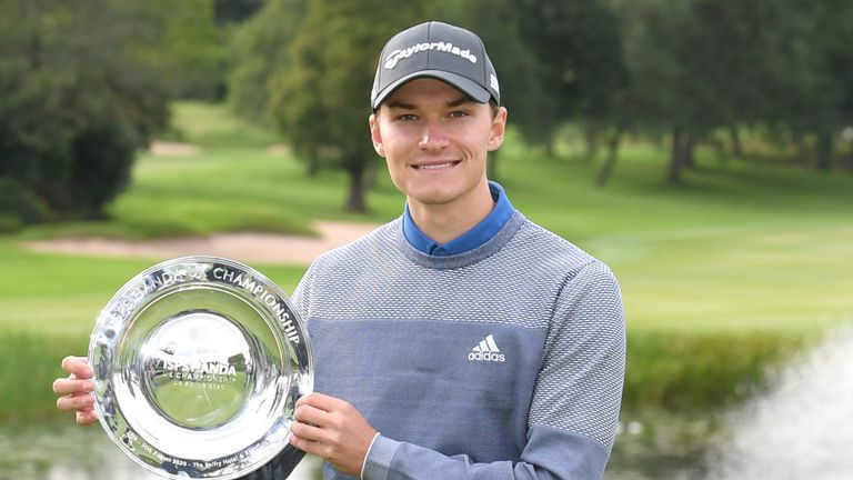 Rasmus Hojgaard with his prize for winning the UK Championship