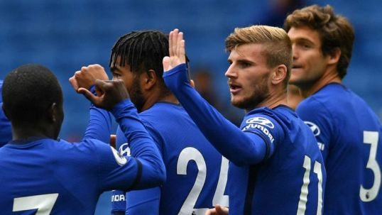 Werner is congratulated by his Chelsea colleagues after his early goal