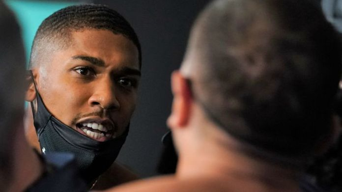 Joshua exchanged words with Pulev before stepping on the scales